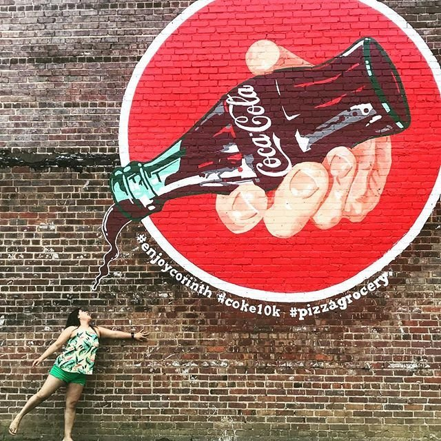 Woman Posing Under Coke Advertisement in Corinth MS