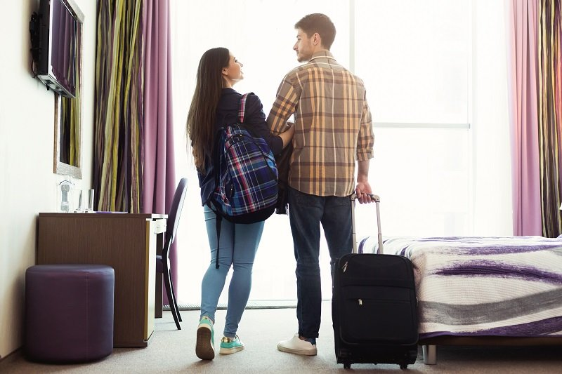 Couple with Luggage in Hotel Room in Corinth MS