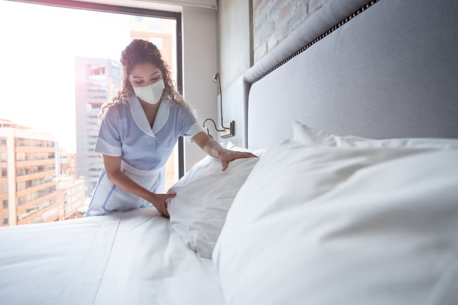 Hotel maid wearing face mask